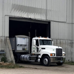 MEI Trucking semi in shed